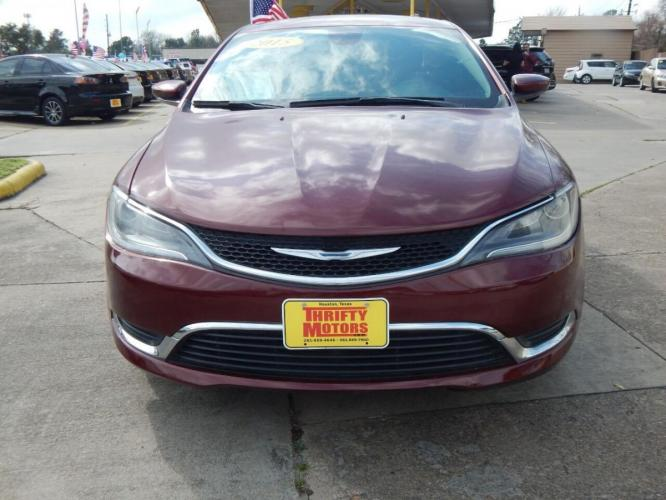 2015 Red Chrysler 200 (1C3CCCAB1FN) with an 2.4L I4 2.4L I4 engine, Automatic 9-Speed transmission, located at 4509 Highway 6 North, Houston, TX, 77084, (281) 859-4646, 29.848997, -95.645760 - Photo #2