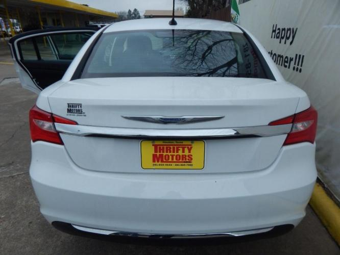 2014 White Chrysler 200 (1C3CCBAB6EN) with an 2.4L I4 2.4L I4 engine, Automatic 4-Speed transmission, located at 4509 Highway 6 North, Houston, TX, 77084, (281) 859-4646, 29.848997, -95.645760 - Photo #3
