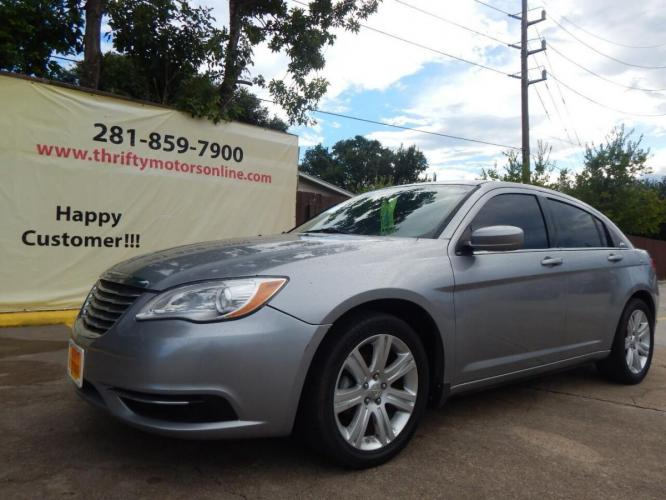 2013 Gray Chrysler 200 (1C3CCBAB4DN) with an 2.4L I4 2.4L I4 engine, Automatic 6-Speed transmission, located at 4509 Highway 6 North, Houston, TX, 77084, (281) 859-4646, 29.848997, -95.645760 - Photo #2