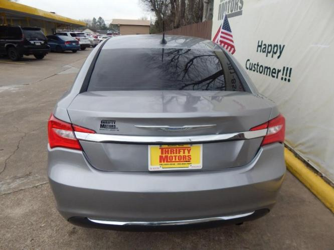 2014 Gray Chrysler 200 (1C3CCBABXEN) with an 2.4L I4 2.4L I4 engine, Automatic 4-Speed transmission, located at 4509 Highway 6 North, Houston, TX, 77084, (281) 859-4646, 29.848997, -95.645760 - Photo #1