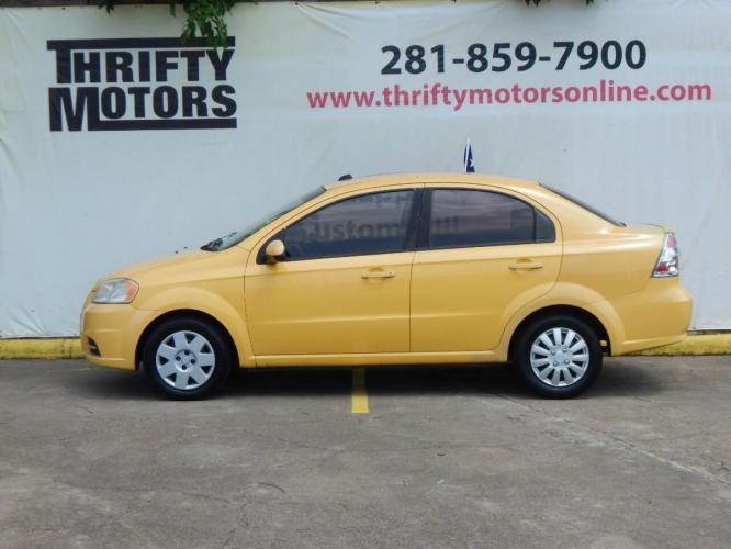 2010 Yellow Chevrolet Aveo (KL1TD5DE5AB) with an 1.6L I4 1.6L I4 engine, Manual 5-Speed transmission, located at 4509 Highway 6 North, Houston, TX, 77084, (281) 859-4646, 29.848997, -95.645760 - Photo #0