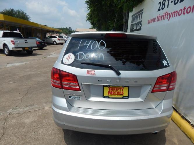 2014 Silver Dodge Journey (3C4PDCAB7ET) with an 2.4L I4 2.4L I4 engine, Automatic 4-Speed transmission, located at 4509 Highway 6 North, Houston, TX, 77084, (281) 859-4646, 29.848997, -95.645760 - Photo #2
