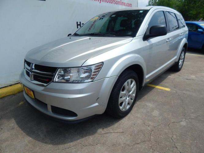 2014 Silver Dodge Journey (3C4PDCAB7ET) with an 2.4L I4 2.4L I4 engine, Automatic 4-Speed transmission, located at 4509 Highway 6 North, Houston, TX, 77084, (281) 859-4646, 29.848997, -95.645760 - Photo #4
