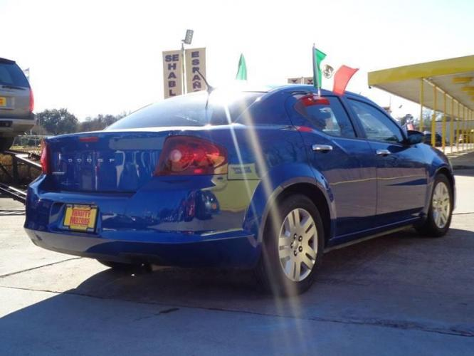 2014 Blue Dodge Avenger (1C3CDZAB8EN) with an 2.4L I4 2.4L I4 engine, Automatic 6-Speed transmission, located at 4509 Highway 6 North, Houston, TX, 77084, (281) 859-4646, 29.848997, -95.645760 - Photo #4