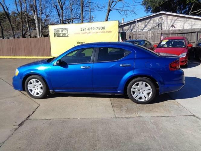 2014 Blue Dodge Avenger (1C3CDZAB8EN) with an 2.4L I4 2.4L I4 engine, Automatic 6-Speed transmission, located at 4509 Highway 6 North, Houston, TX, 77084, (281) 859-4646, 29.848997, -95.645760 - Photo #7
