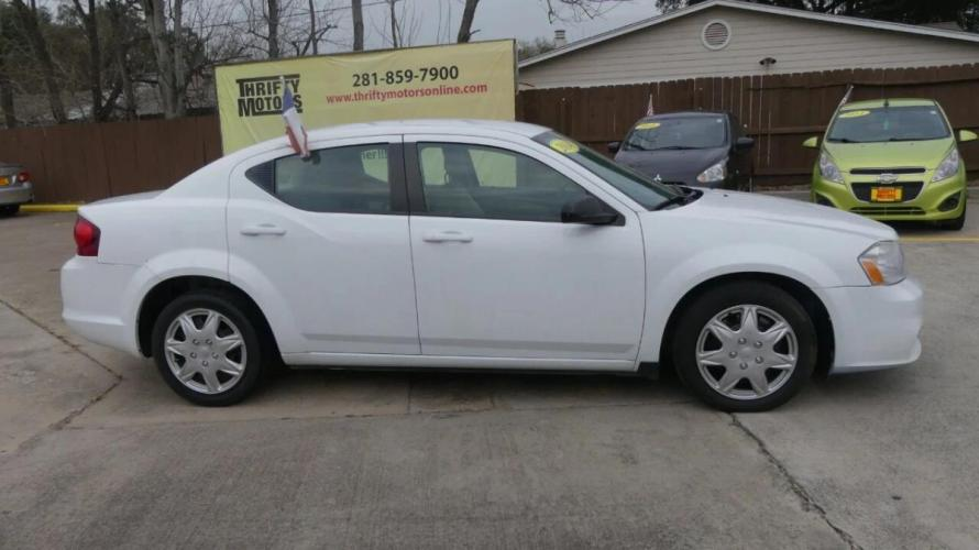 2014 White Dodge Avenger (1C3CDZAG9EN) with an 3.6L V6 3.6L V6 engine, Automatic 6-Speed transmission, located at 4509 Highway 6 North, Houston, TX, 77084, (281) 859-4646, 29.848997, -95.645760 - Photo #4