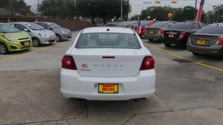 2014 White Dodge Avenger (1C3CDZAG9EN) with an 3.6L V6 3.6L V6 engine, Automatic 6-Speed transmission, located at 4509 Highway 6 North, Houston, TX, 77084, (281) 859-4646, 29.848997, -95.645760 - Photo #6