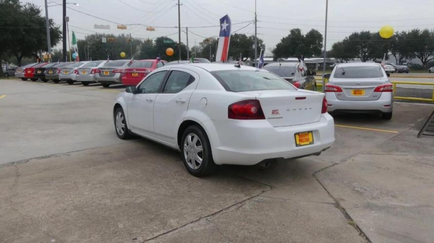 2014 White Dodge Avenger (1C3CDZAG9EN) with an 3.6L V6 3.6L V6 engine, Automatic 6-Speed transmission, located at 4509 Highway 6 North, Houston, TX, 77084, (281) 859-4646, 29.848997, -95.645760 - Photo #7